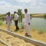 Programme team reviewing the newly constructed azolla pit in programme area
